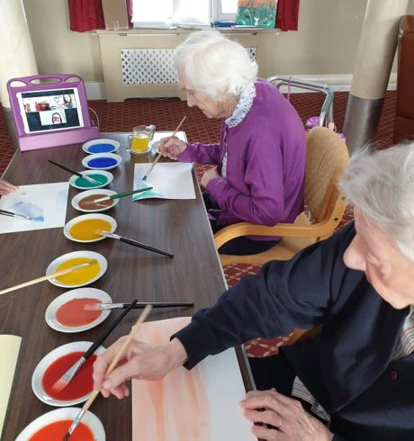 Ladies painting at Ancaster House as part of remotely-led arts project