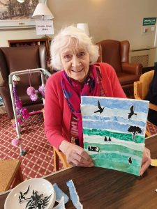 A care home resident with her painting. Part of Creative Ageing in the Pandemic project