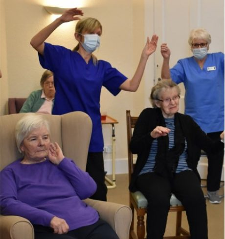 Staff and residents at Anderson's Care Home dancing during Chris Stuart-Wilson's digital dance session
