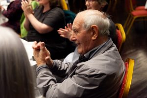 Man clapping at the Stornoway Come and Sing event, September 2019