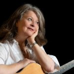 Christine Kydd with guitar