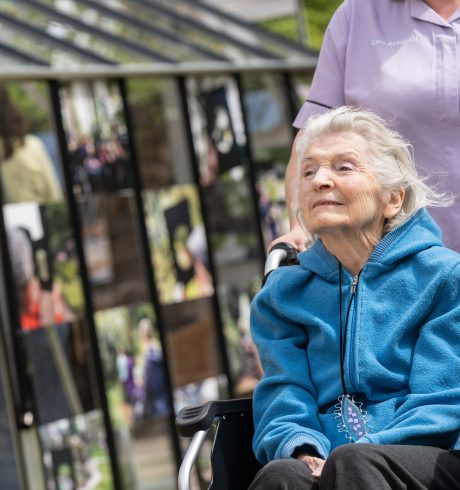 Lady in a wheelchair looking at artwork at Erskine care home as part of Art Adventures in Nature